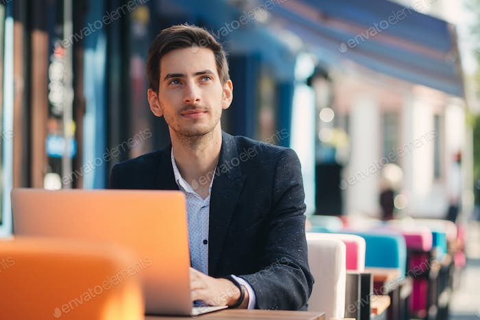 Ambitious entrepreneur working at the laptop