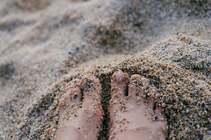 Woman feet in sand. Summer vacation concept