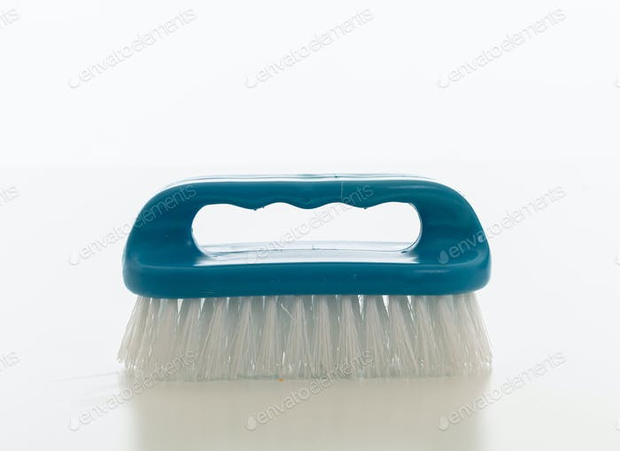 Cleaning brush blue color isolated against white background.