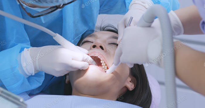 Dentist examines the patient teeth