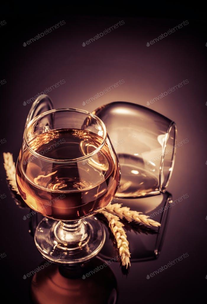 cognac glass on black