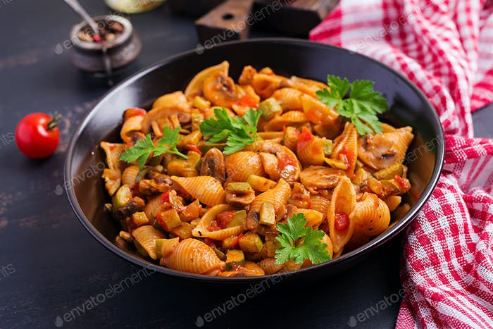 Conchiglie pasta. Italian pasta shells with mushrooms, zucchini and tomato sauce.