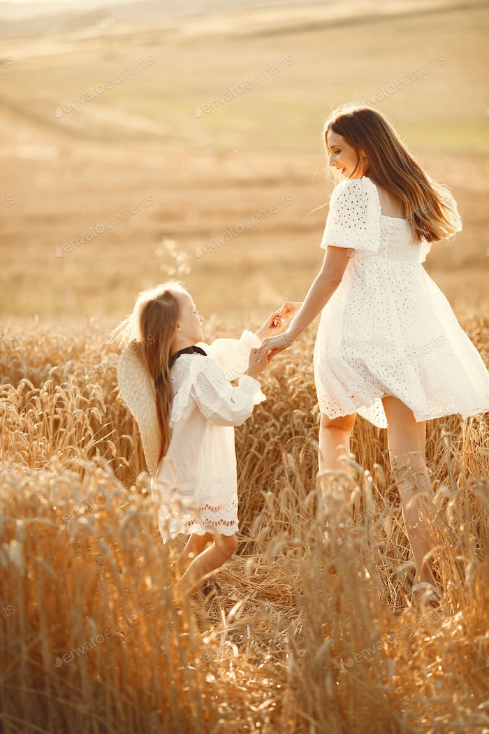 Mother with daughter in a wheat field