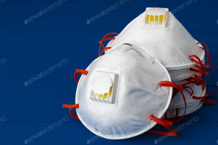 White medical mask for protection against viruses and pollution
