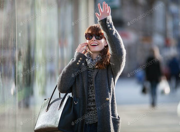 Woman in rush on street using mobile phone