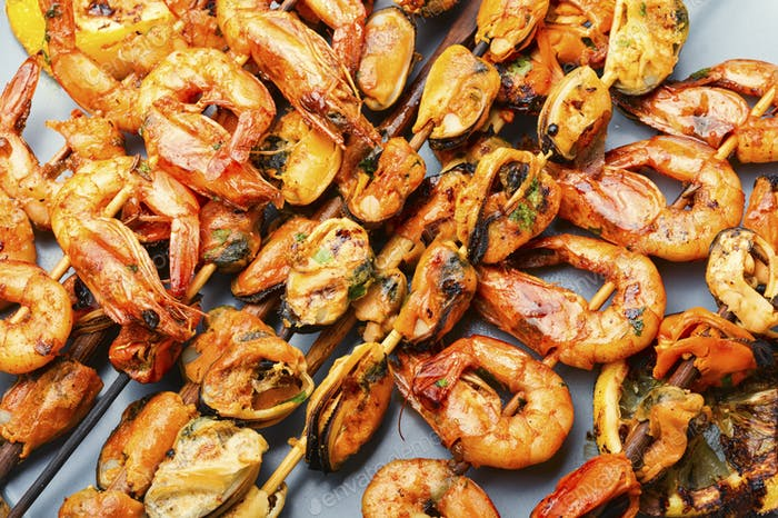 Grilled shrimp and mussels skewers