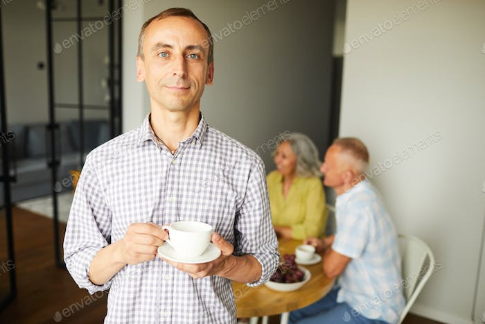 Mature Man Posing with Cup of Tea