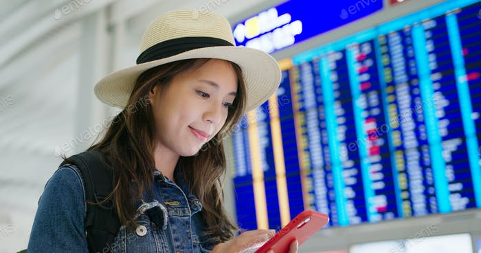 Woman check on smart phone in the airport