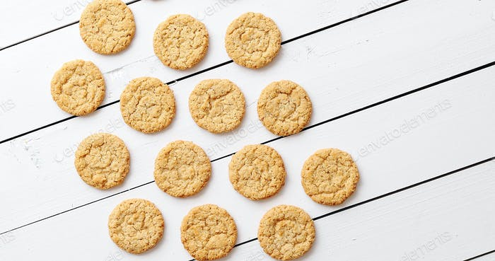 Healthy oatmeal cookies on white wood background, top view