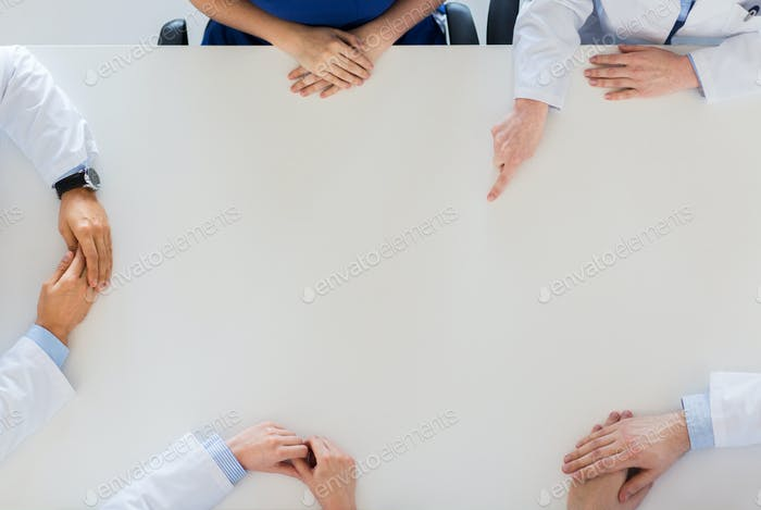 doctor hand showing something imaginary on table