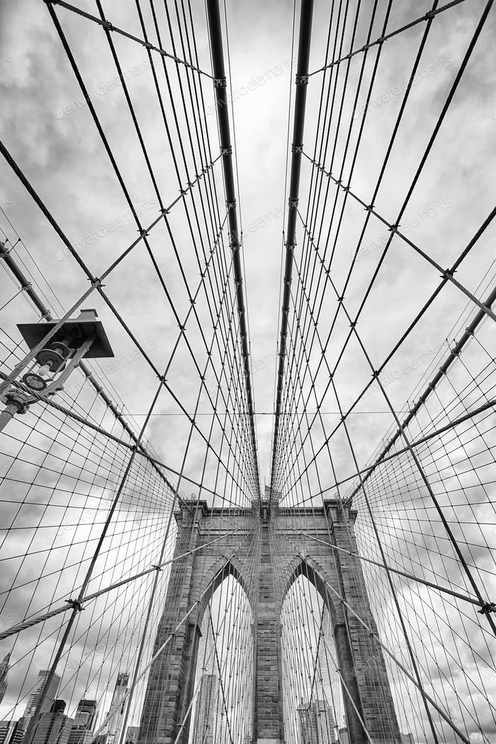 Looking up at the Brooklyn Bridge, New York City.