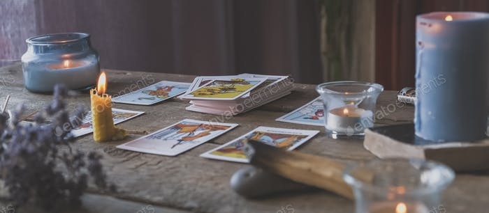 Tarot cards, Fortune telling on tarot cards at night by candlelight, magic crystal, occultism,