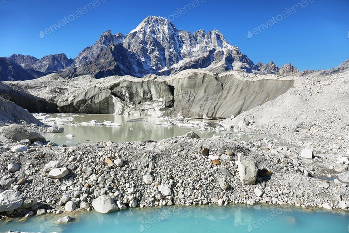 View blue lagoon in Khumbu moraine near Gokyo, Nepal