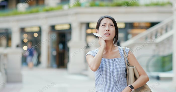 Woman feeling so hot in the city
