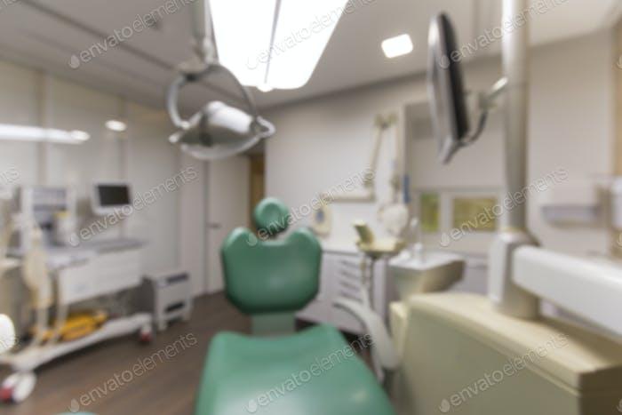 Blurred photo of children dentist chair in dentistry