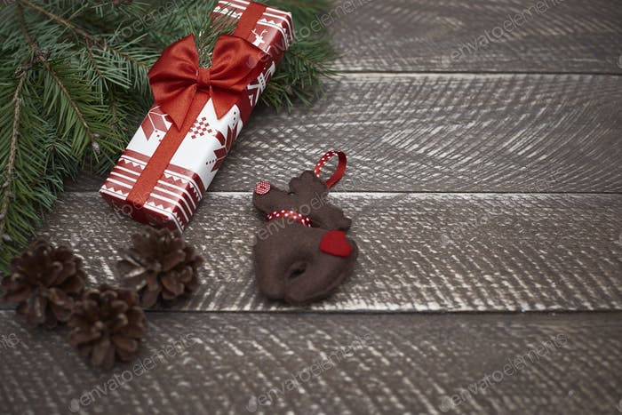 Natural plank and christmas ornaments