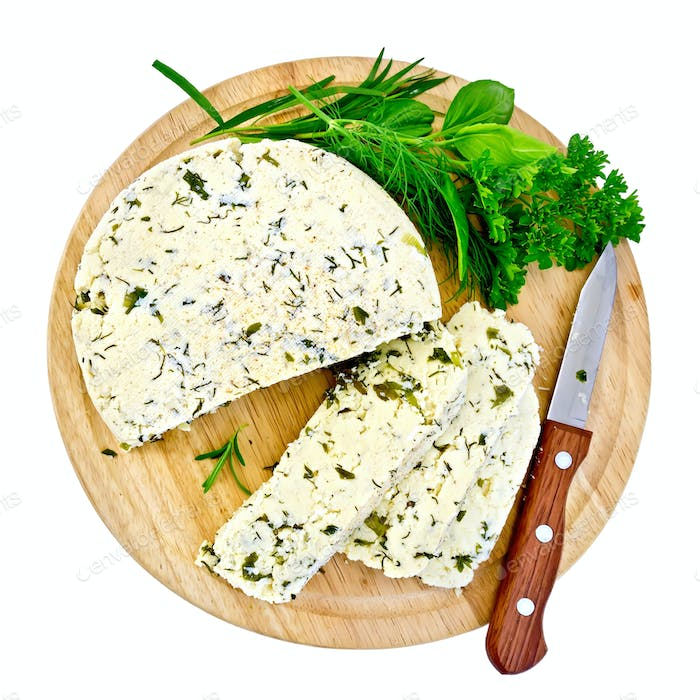 Cheese homemade with knife and herbs on round board
