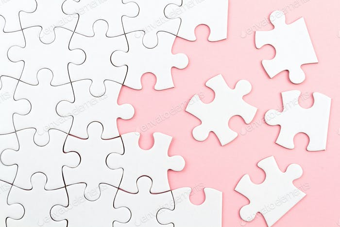 White puzzle over pink backround with missing pieces. Incomplete elements, solution search concept