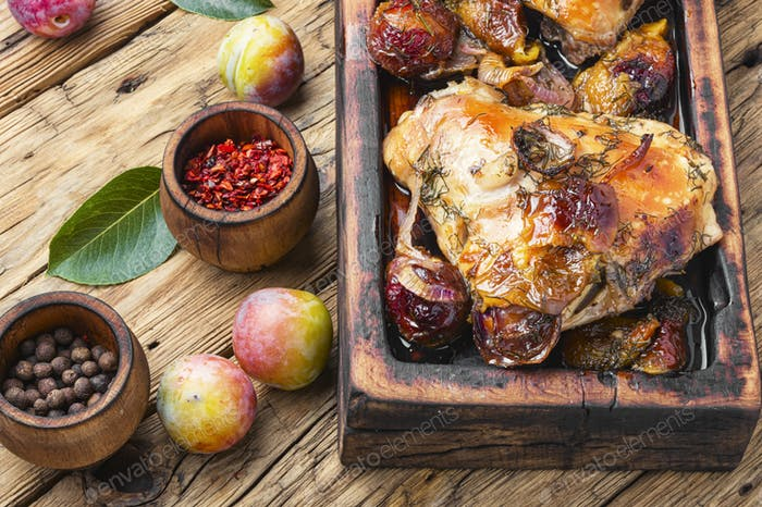 Roasted chicken stuffed with plum