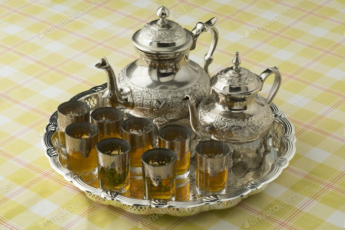 Moroccan tea with and without sugar and glasses with absinthium herb