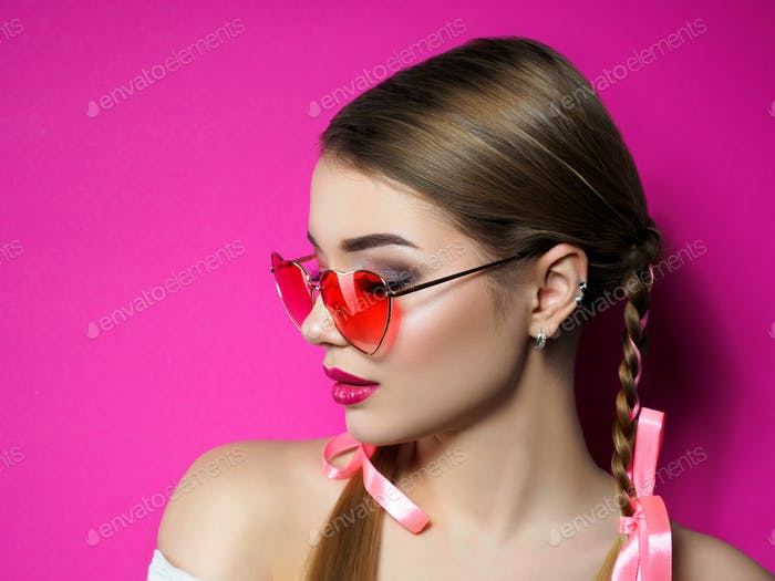 Young woman wearing heart shaped glasses
