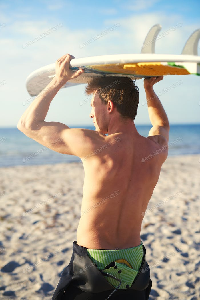 Thumbnail for Athletic Guy Holding His Surfboard Over his Head
