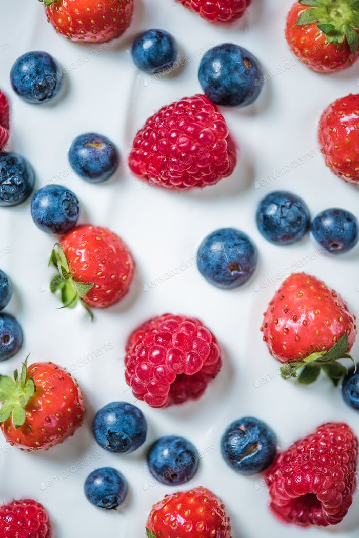 Fresh berries on yogurt
