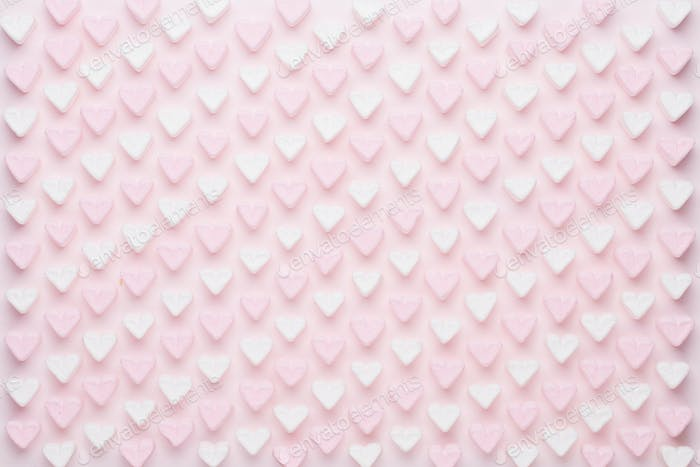 Marshmallows on pink background with copyspace.