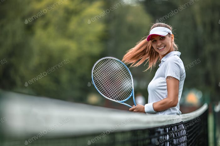 Beautiful girl with a racket on the court