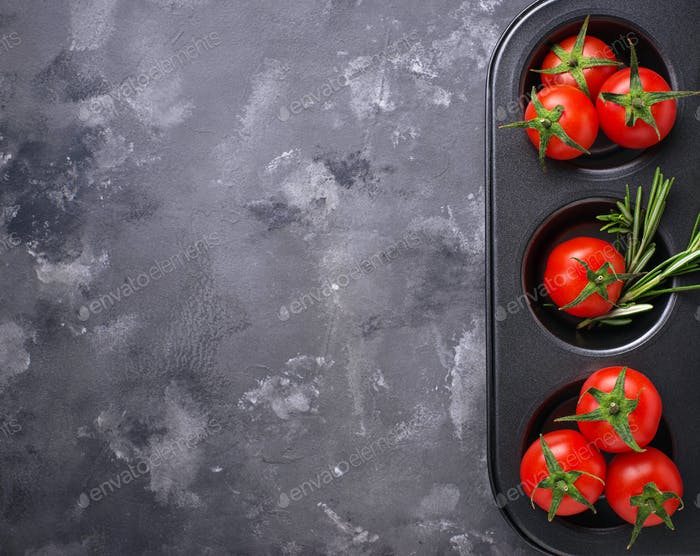 Fresh cherry tomatoes on grey table