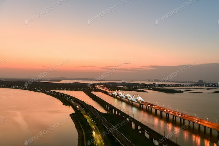 lake and bridge in nightfall