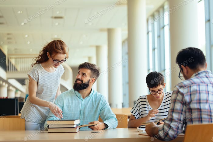 Group of college students studying