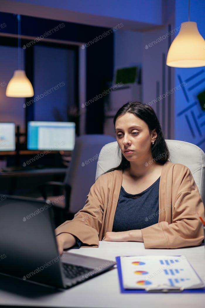 Skilled businesswoman working on computer