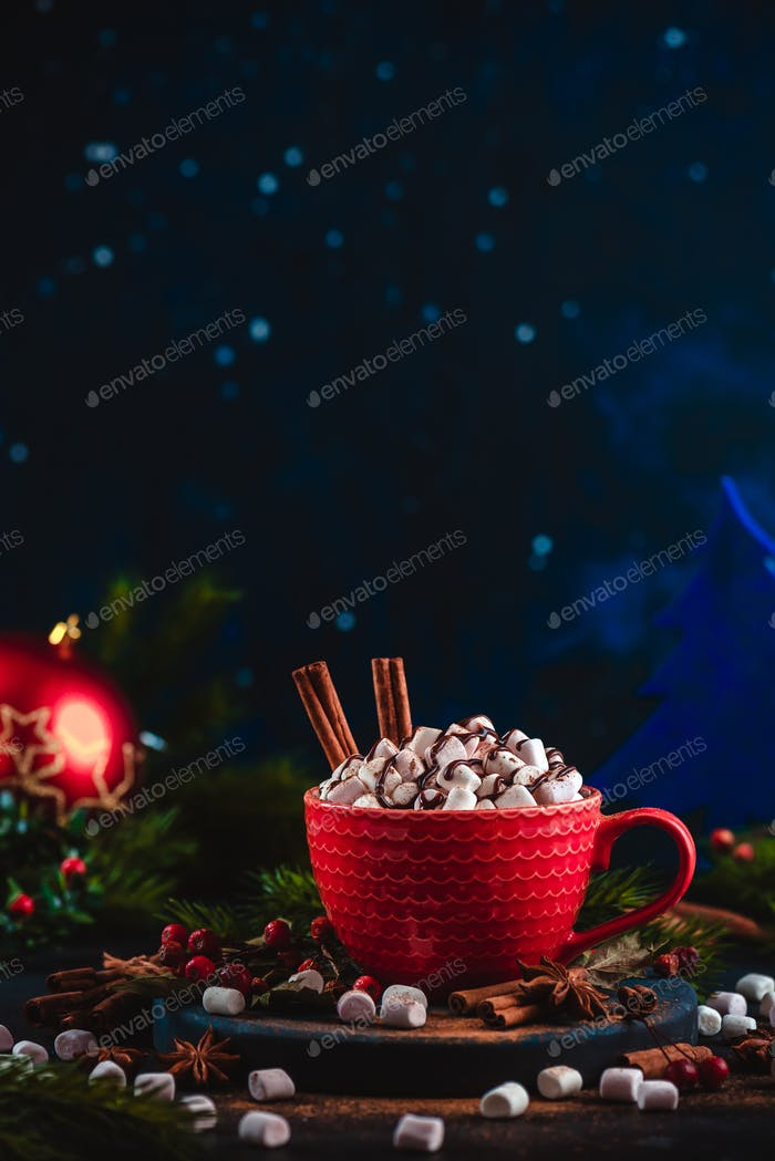 Christmas hot chocolate with marshmallows, chocolate crumbs, and syrup. Large coffee cup with