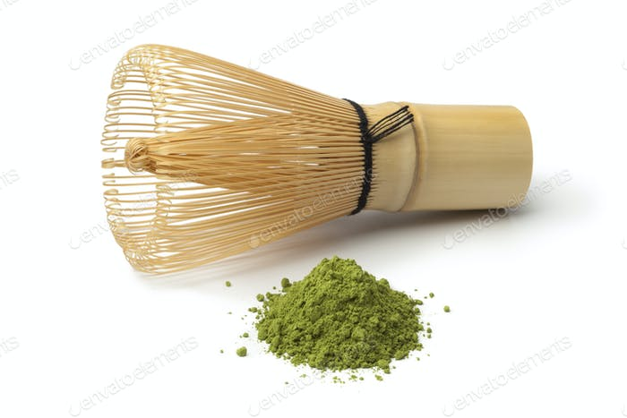 Heap of matcha tea and a whisk