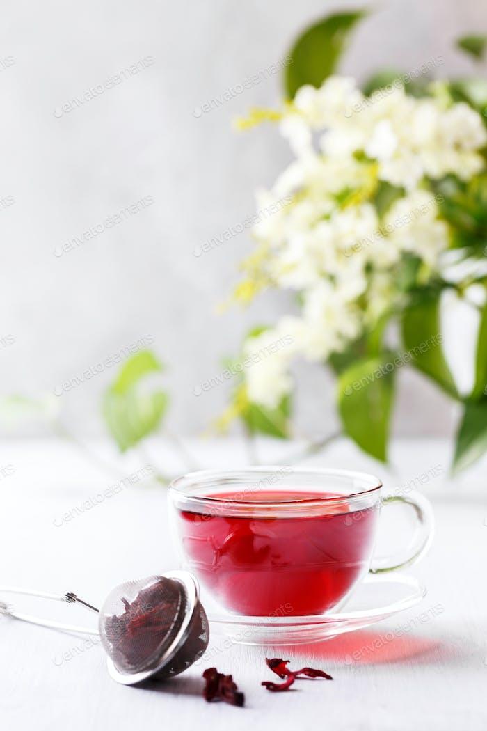 Cup of hibiscus tea, vertical shot