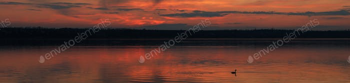 Amazing sunset with clouds and river. Nature background
