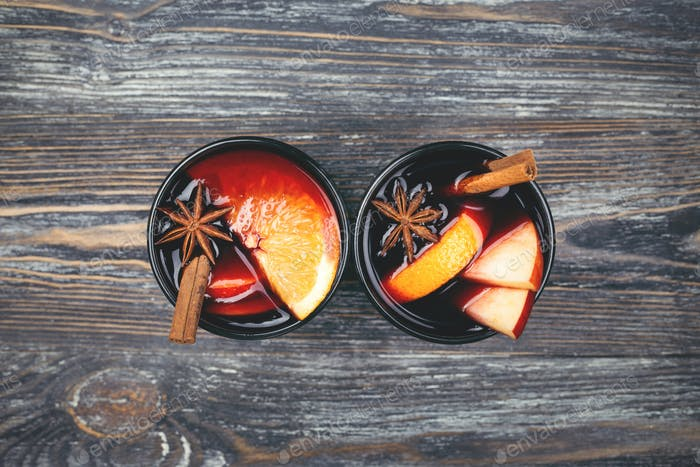 Two Glasses of Mulled Wine on Wooden Table.