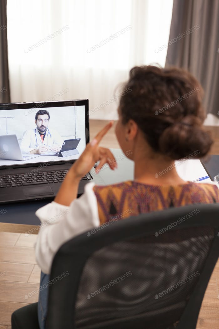Patient in a video call with doctor