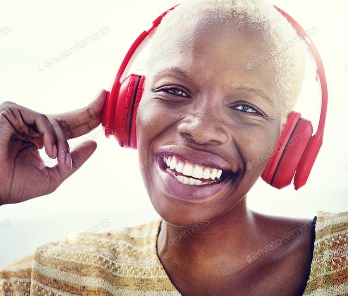 African Woman Headphones Listening Music Concept