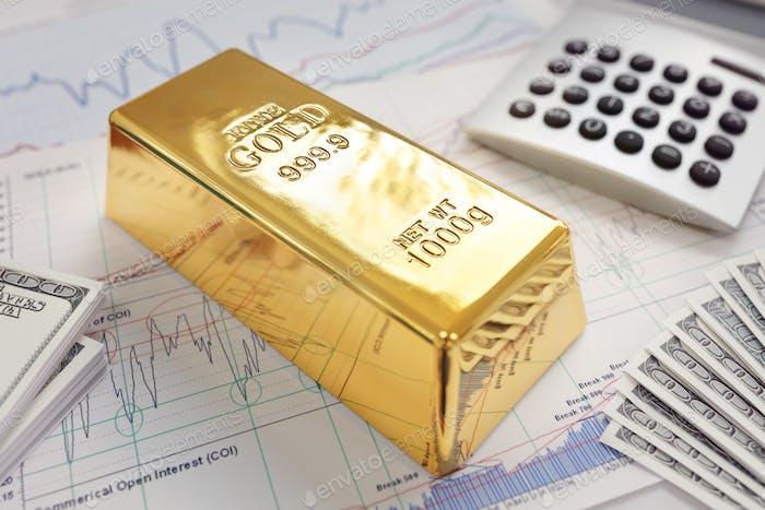 Goldbarren auf einem Aktien- und Aktiendiagramm