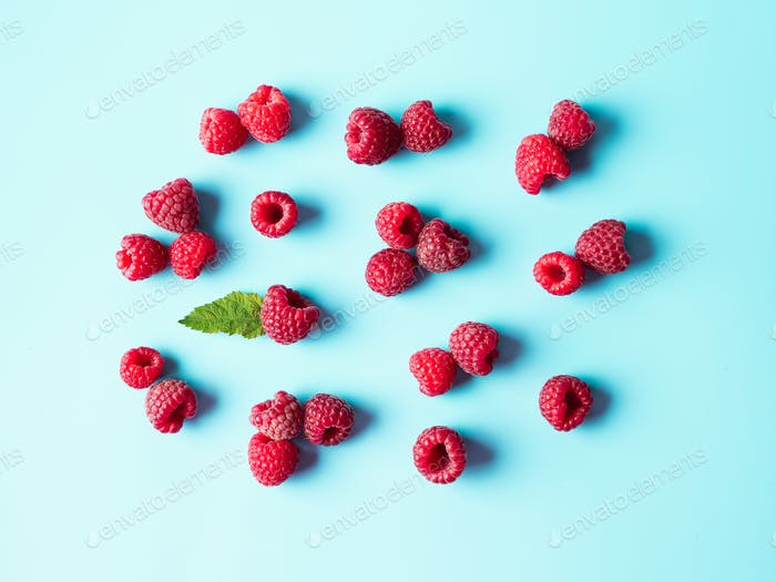 Raspberry pattern, blue background, top view
