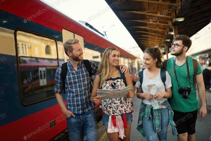 Happy group of tourists traveling and sightseeing