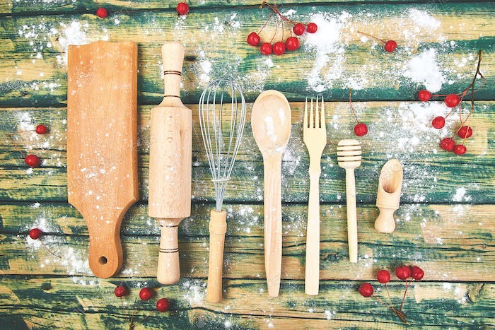 Cooking or baking food background with kitchen utensils