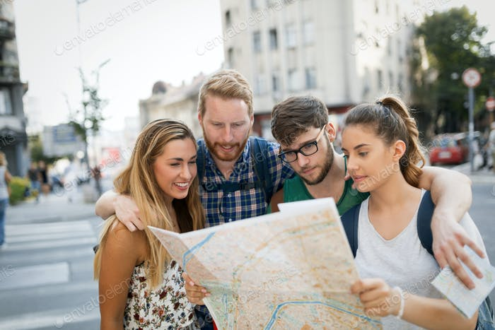 Tourist friends discovering city on foot