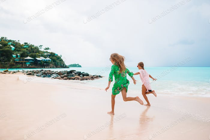 Kids have a lot of fun at tropical beach playing together