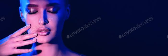 Model posing in studio in colorful neon lights