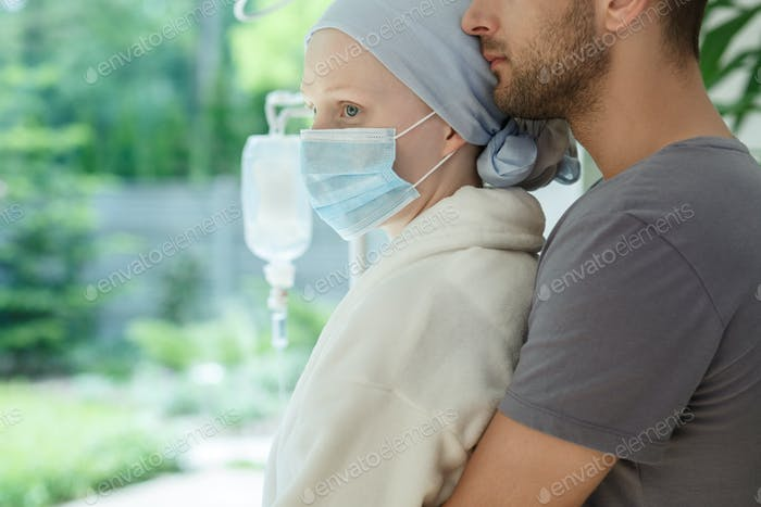 Hugging wife with malignant cancer