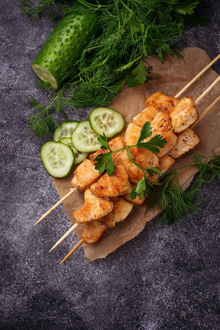 Chicken shish kebabs with green salad
