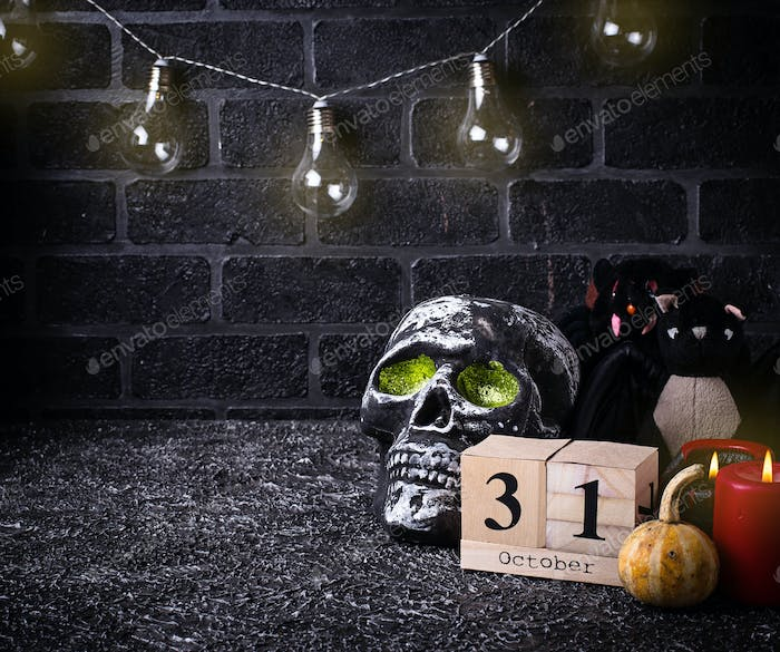 Halloween background with skull and candles